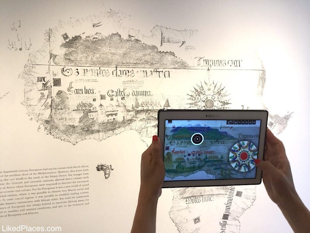 Algarve, hands with tablet in the Museological Nucleus of the Route of the Slavery in Lagos