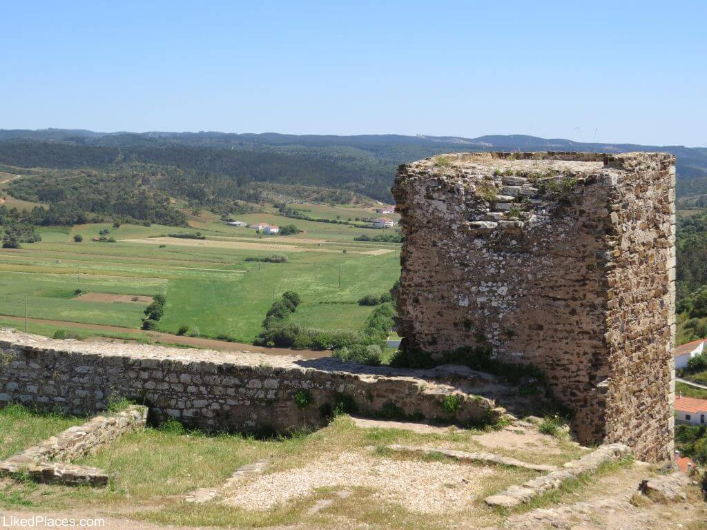 Lowland view and square tower of Aljezur castle, Aljezur
